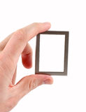 Small frame. The hand holding the frame. Isolated on white stock images