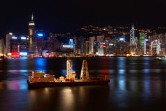 Small freight ship in Hong Kong at night Royalty Free Stock Photo