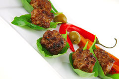 Small french beef cutlets on basil Stock Images