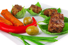 Small french beef cutlets on basil Stock Photo