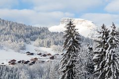 Small French village in Alps in winter near the peak. Small French village in Alps in winter Royalty Free Stock Image