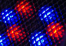 Small fresnel lens arranged in array with blue and red leds behind Royalty Free Stock Photos