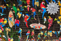 Small fridge magnets with parrots, welcome and sun Royalty Free Stock Photos