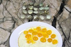 Small Fried eggs made of quail eggs . royalty free stock image