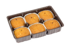 Small fruitcakes in container Royalty Free Stock Images