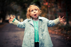 Small funny baby singing. Outside Royalty Free Stock Photography