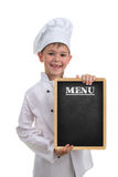 Small funny chef in white uniform holding a menu board, on white background. stock photo