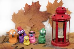 Small funny figures made from Play Clay. Autumn abstraction.  royalty free stock photo