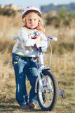 Small funny kid with bike Stock Photos