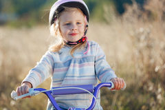 Small funny kid with bike Royalty Free Stock Image