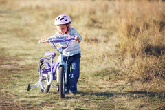 Small funny kid with bike Royalty Free Stock Photos