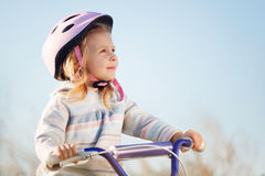 Small funny kid riding bike Stock Images