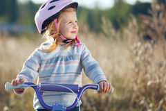 Small funny kid riding bike Royalty Free Stock Photography