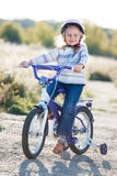 Small funny kid riding bike Royalty Free Stock Images