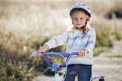 Small funny kid riding bike Royalty Free Stock Photo