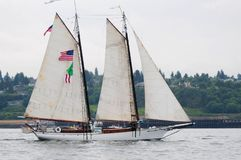 Sailing Schooner Underway on Puget Sound. Small, gaff rigged sailng schooner underway in Tacoma Tall Ships Festival, 2005.  Calm waters, overcast sky Stock Image