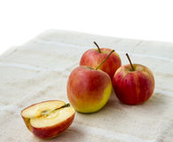 Small gala apple and half on nakin over white. Stock Images