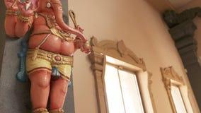 Small Ganesha Statue on Wall. Handheld, medium close up shot of a small Ganesha statue on the wall stock video footage