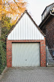 Small garage made by red bricks Stock Images