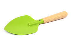 A small garden spade in green on white background Royalty Free Stock Photo