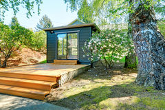 Small garden studio in a separate room with window walls. Small garden studio in a separate room with window walls and deck Stock Photo