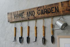 Small garden tools hanging on the wall Stock Photos