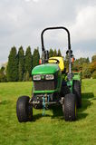 Small garden tractor on public land. Stock Images