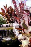 Small garden waterfall. Small waterfall in restaurant garden Royalty Free Stock Photo