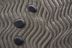 Small Garden zen. Drawings on light gray sand and black stones in a small Zen garden Stock Photo