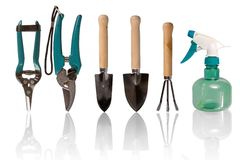 Small gardening tools. Five gardening tools and one spaying bottle stock photos