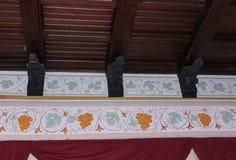 Small gargoyles under the ceiling. Royalty Free Stock Photo