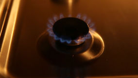 Small gas burner. A small gas burner with blue flames in soft light, and turning on and off stock video footage