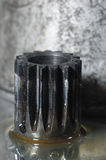 Small gear drenched in oil Royalty Free Stock Images