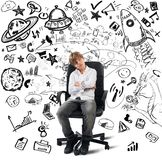 Small genius. Concept of small genius with kid and varius drawings Royalty Free Stock Images
