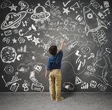 Small genius. Concept of small genius with kid and varius drawings stock photos