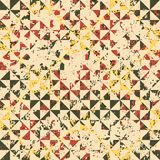 Small geometric abstract mosaic pattern. With triangles and simple shapes in vintage colors for fall winter fashion. Abstract dynamic retro tiles background Royalty Free Stock Images