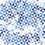 Small geometric abstract mosaic pattern. With triangles and simple shapes in blue colors for fall winter fashion. Abstract dynamic retro tiles background Royalty Free Stock Image