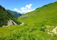 Small Georgian village in the Caucasus Mountains. Georgian village in the Caucasus Mountains royalty free stock images