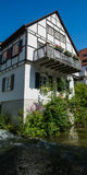 Small German Cottage with Balcony on River Ulm Stock Photo