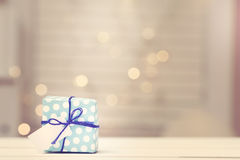 Small gift box on abstract light Stock Photos