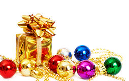 Small gift box and baubles. Small gift box and colorful baubles Stock Photography