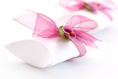 Small gift box decorated with ribbon Stock Image