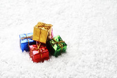 The small gift box group on snow for decoration christmas stock photo