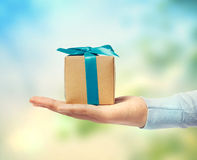 Small gift box on hand Royalty Free Stock Images
