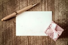 Small gift box and pen with blank Royalty Free Stock Images