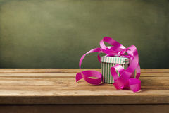 Small gift box with pink ribbon Stock Image