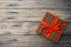 Small gift box with red ribbon Stock Image