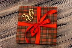 Small gift box with red ribbon Stock Images