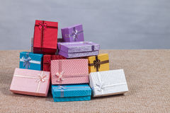 Small gift box set on sack cloth. Background,vintage tone Stock Image