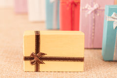 Small gift box set on sack cloth. Background,vintage tone Royalty Free Stock Images